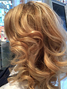 Stunning curls provided by blow dry treatment