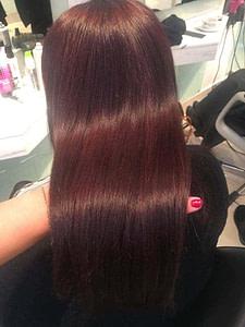 Long brown hair with a faint dark red tone