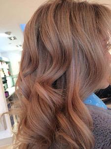 Close up of volumised, fair wavy hair