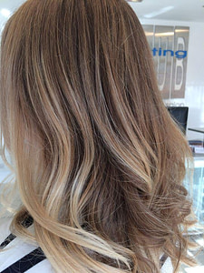 Long wavy blonde hair and alternate Cutting Club logo