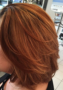 Shoulder length natural red hair with strawberry highlights