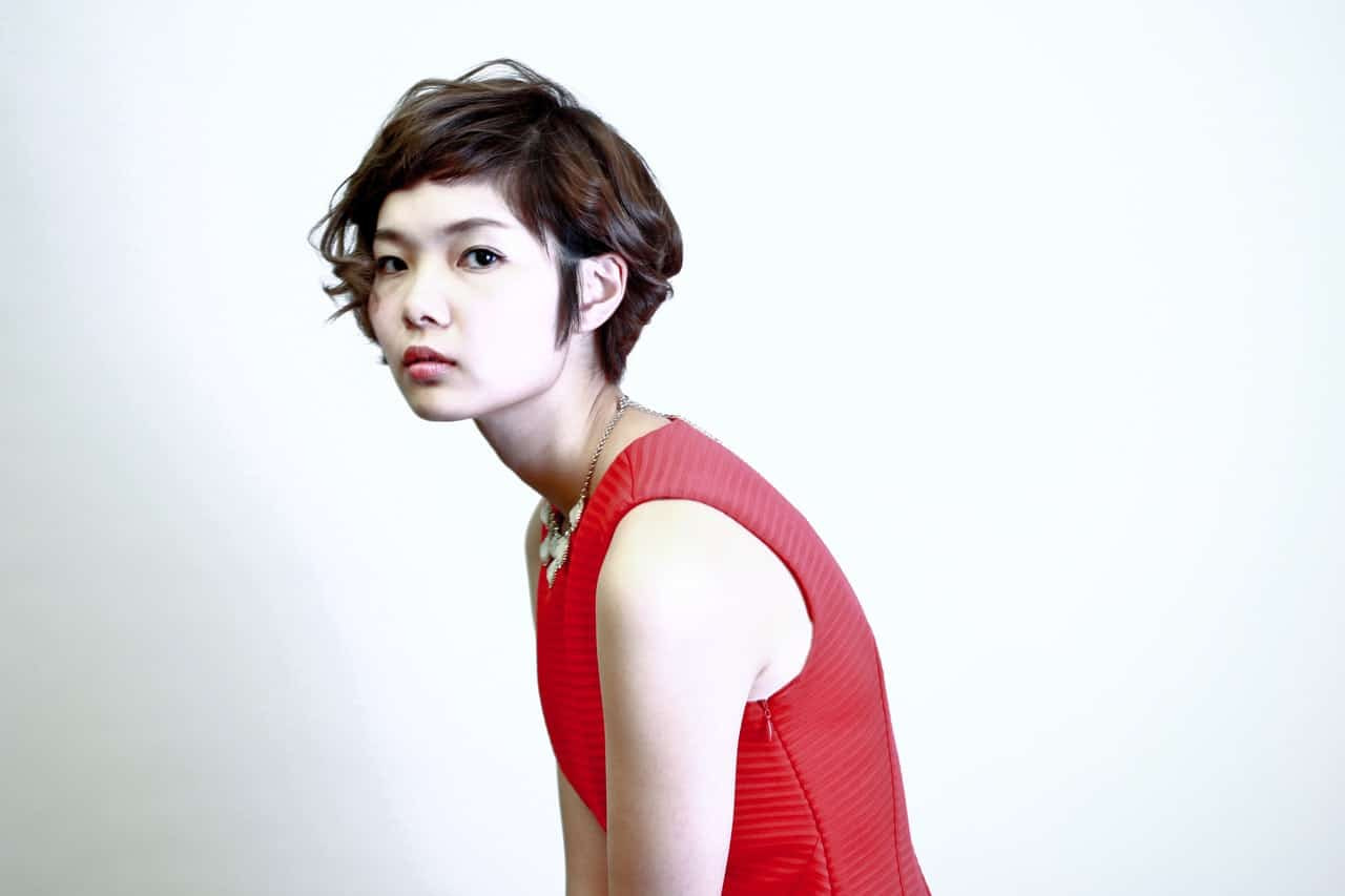 Woman in red dress with short brown hair