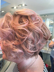 Volumised and Blow Dried Short Blonde Hair with Pink Highlights