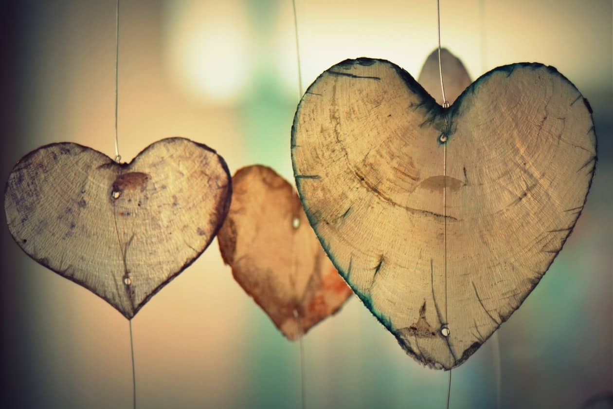 Wooden carved love hearts on string