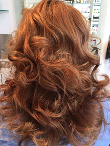 Wavy blow out on long light brown hair